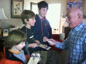 Joseph, Timothy and Lawson of Birmingham giving their treasure to Bud Ozar